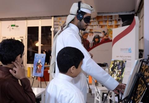 The College of Humanities and Social Sciences booth at Darb Al Saai